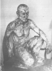 Mineur accroupi une sculpture en plâtre d'Edouard Coulon